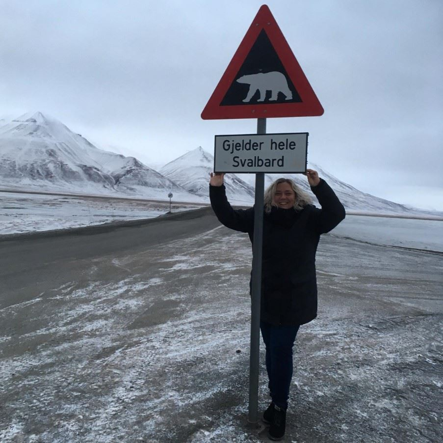 Michelle at the Svalbard sign