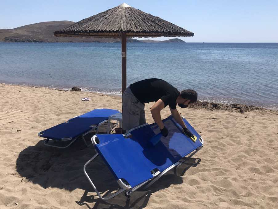 Disinfecting the sun loungers on Platy beach, Lemnos